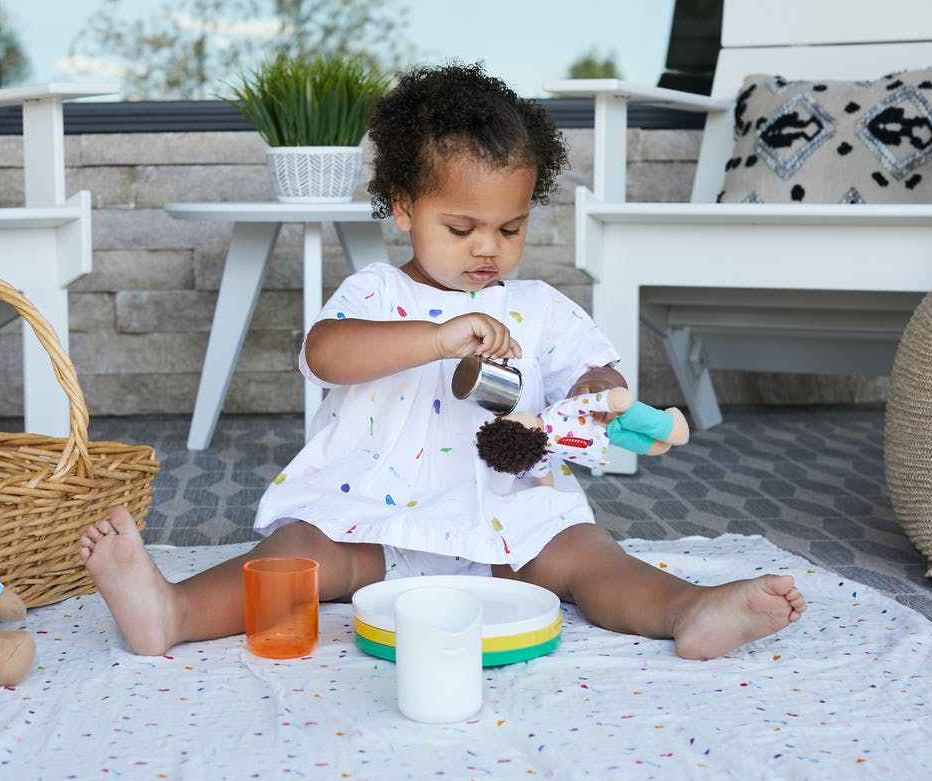 toddler having a picnic outside
